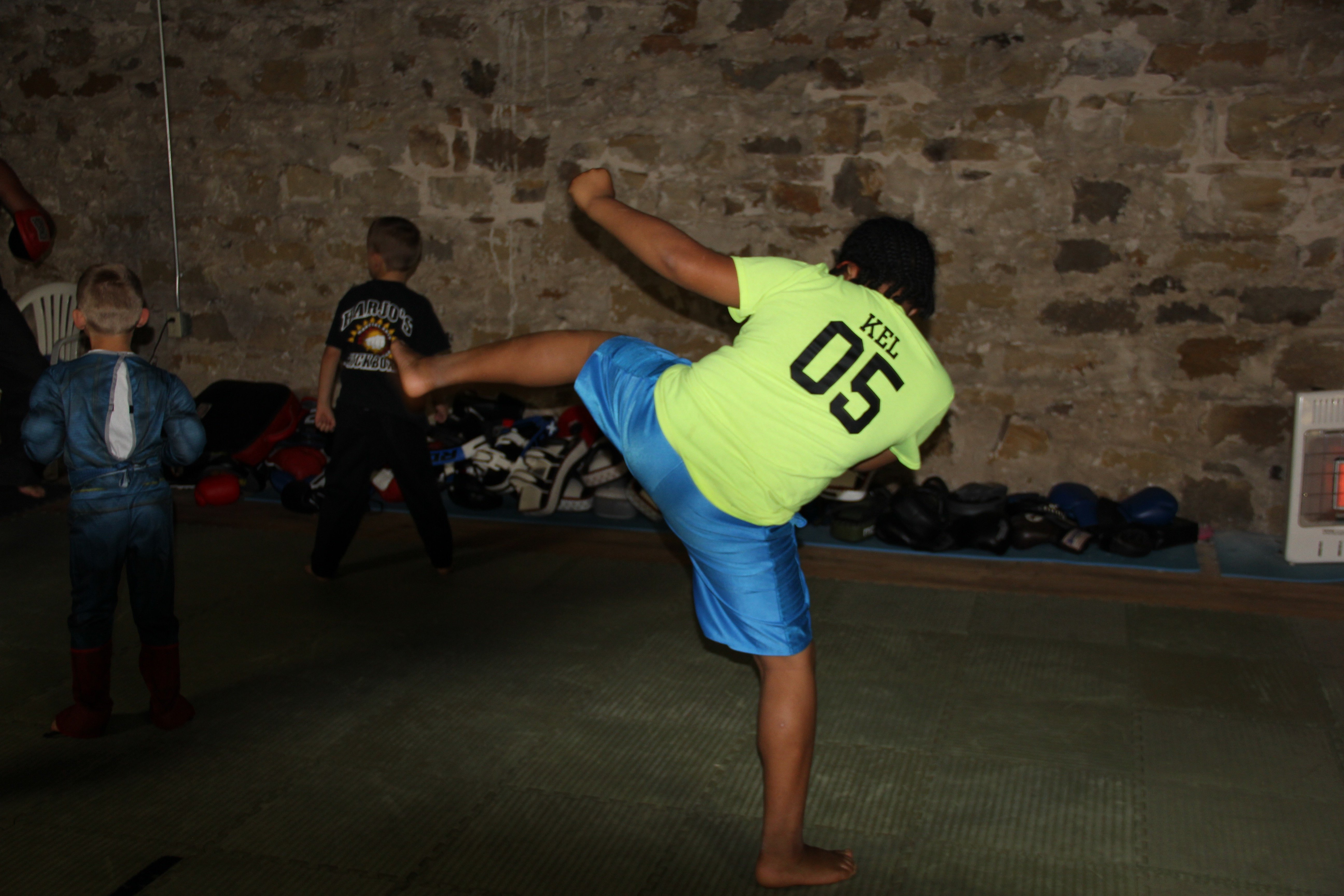 One of Brownie's students throws a back kick during his youth class.