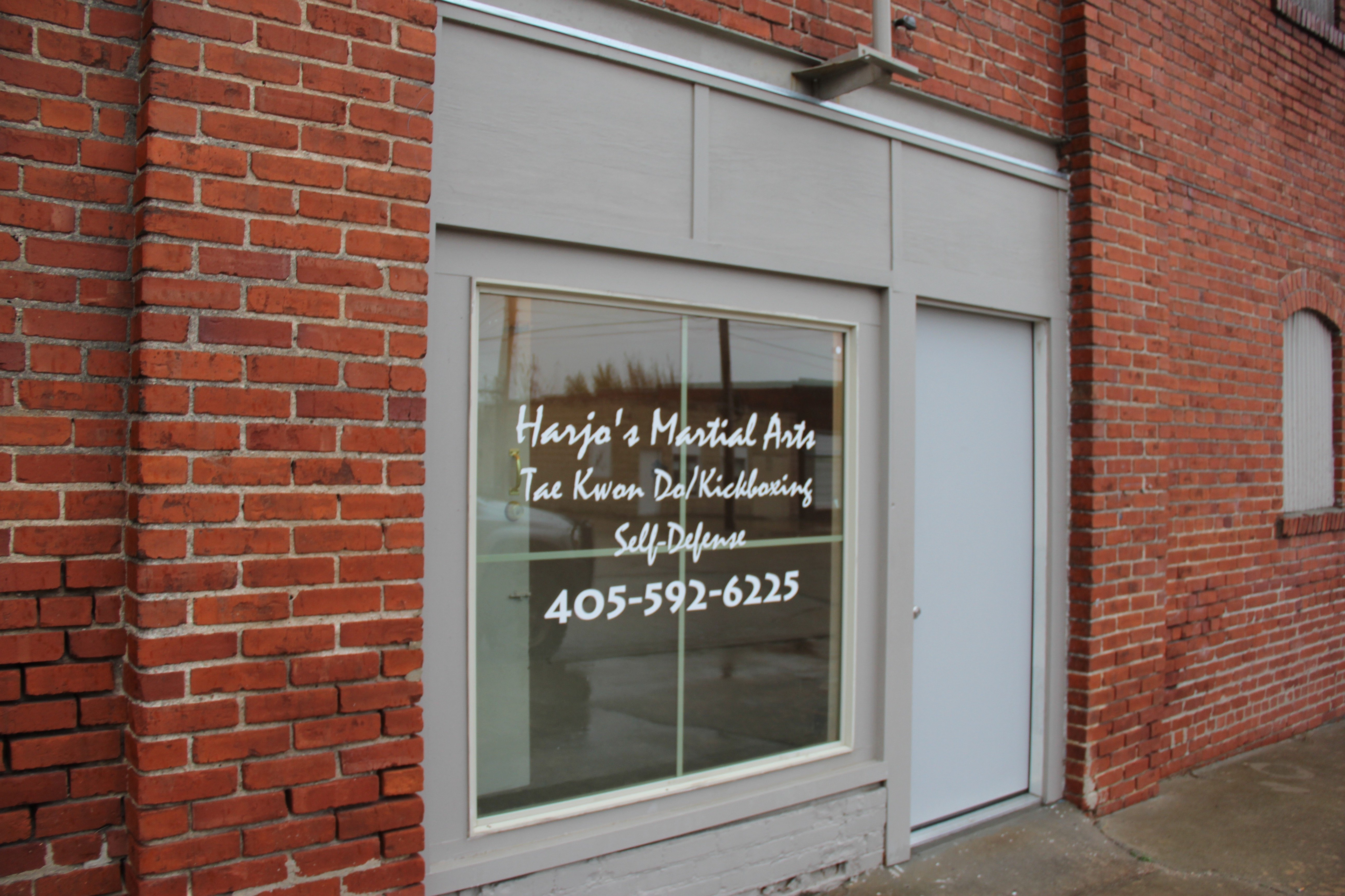 A sign for Harjo's Martial Arts on Broadway in downtown Holdenville.